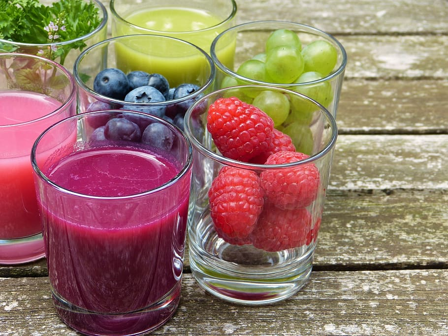 fruit and smoothies in glass on a table